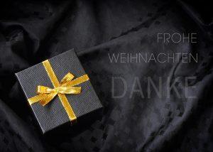 virtuelle, extravagante Weihnachts E-Card in schwarz mit goldenem Geschenkpaket (327)
